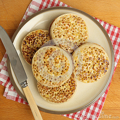 buttered-crumpets-plate-hot-english-33624729