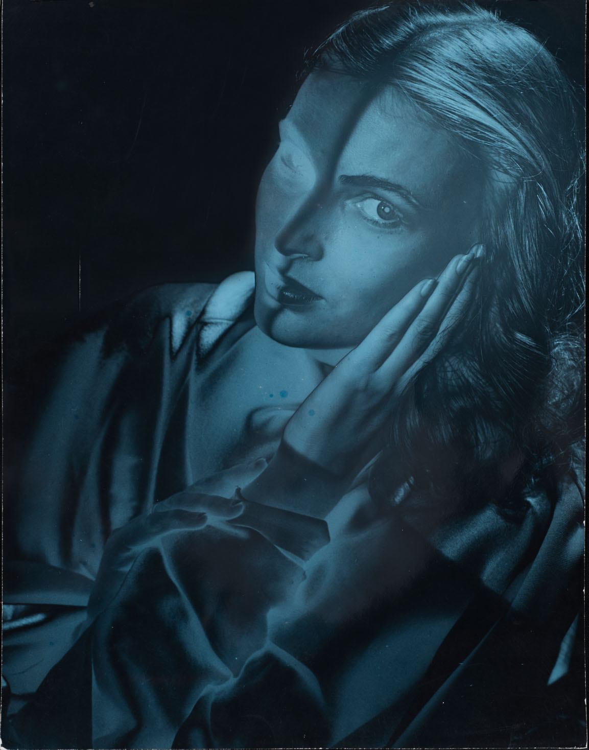 Erwin-Blumenfeld-Dyed-Blue-Solarized-model-with-Face-on-Hands-New-York-1946-Silver-Gelatin-Print-Courtesy-Osborne-Samuel