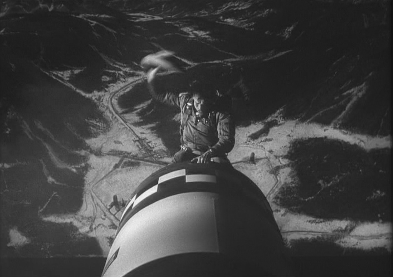 Scene from Doctor Strangelove:  Man riding atomic bomb to earth.