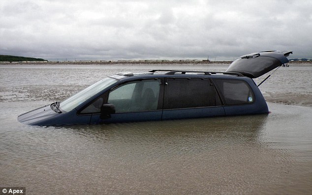 sunk car in sand