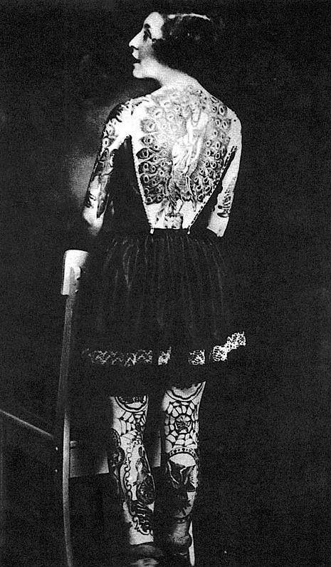 Жена татуировщика, 1905 год. И другие удивительные фотографии. cc64a50f4a3740b83d0109126200856f.jpg