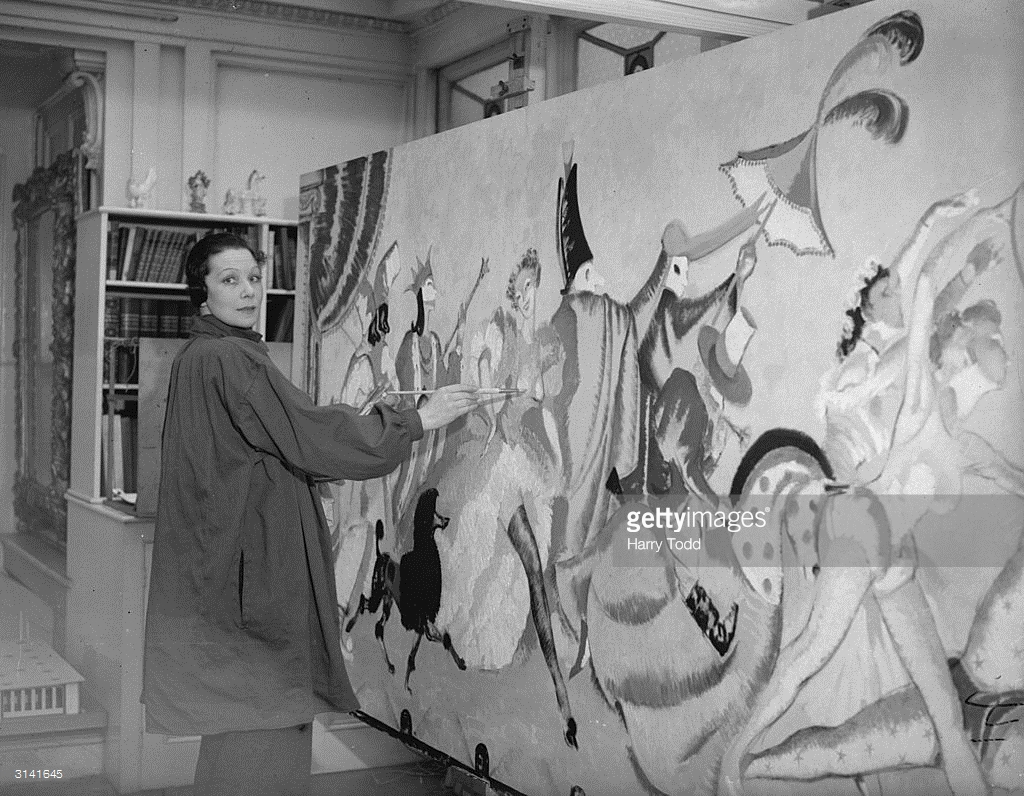 Doris Zinkeisen in her London studio at work on one of her paintings for the grill.jpg