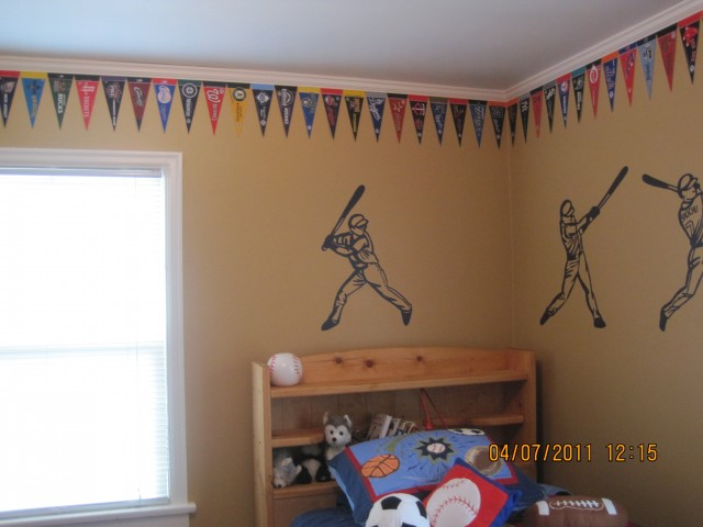 Jack has every baseball, basketball and football team represented. Hubby put up the awesome moulding. Lots of swearing on that one.