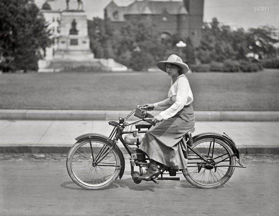 Washington, D.C., circa 1918. Woman on motorized bicycle.