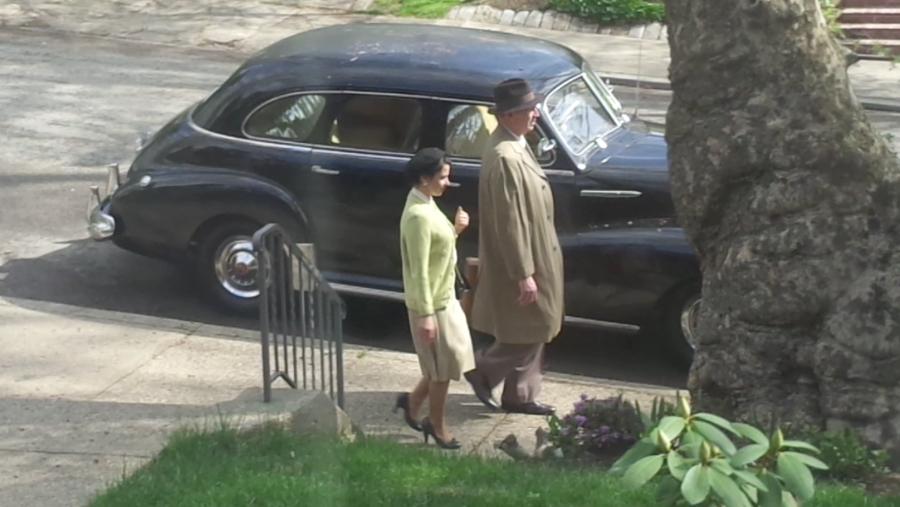 "suddenly it""s 1950 still of people car"