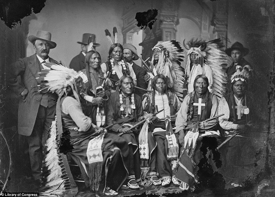 A delegation of visiting Sioux and Arapaho, including Red Cloud, seated at left, and Little Big Man, standing at Red Cloud's left, pictured in September 1877