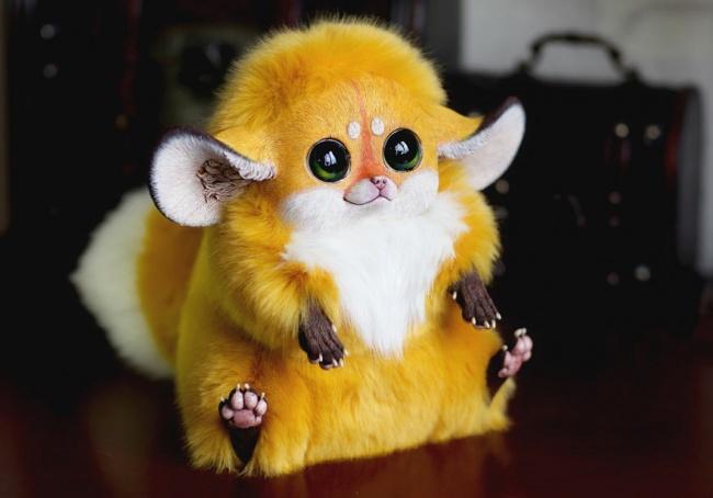 3111455-R3L8T8D-650-cool-yellow-Furby-plush-toy
