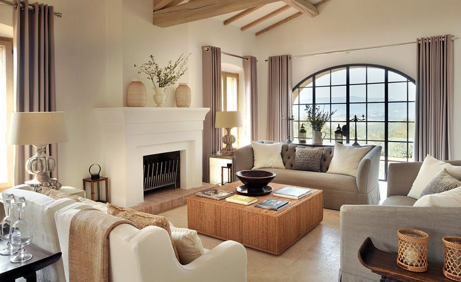 nice-rattan-table-with-white-and-grey-sofas-also-beautiful-fireplace-927x568