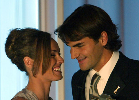 Martina Hingis is taking Roger Federer's offer to play mixed doubles at the 2012 Olympics very, very seriously.