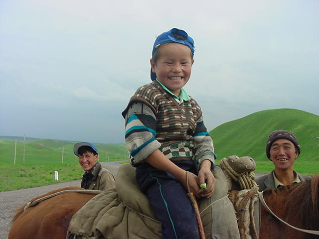Osh_Papan_road_2003_Kyrgyz_boy_horseback