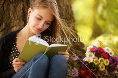 stock-photo-16991549-girl-reading-in-the-nature