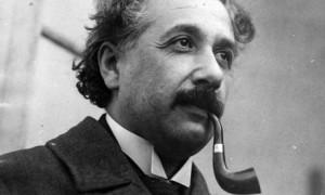 Einstein Smoking a pipe Image, Cheeky Grin