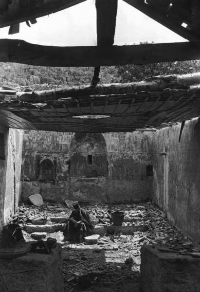 A Greek Orthodox priest in a destroyed church, probably from Balkan Wars, in Kastri, Preveza, Greece, 1913