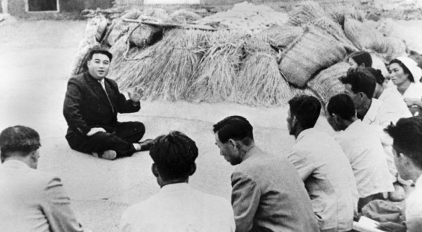 Communist leader Kim Il Sung chats with farmers from South Pyongyang in North Korea. October 1945