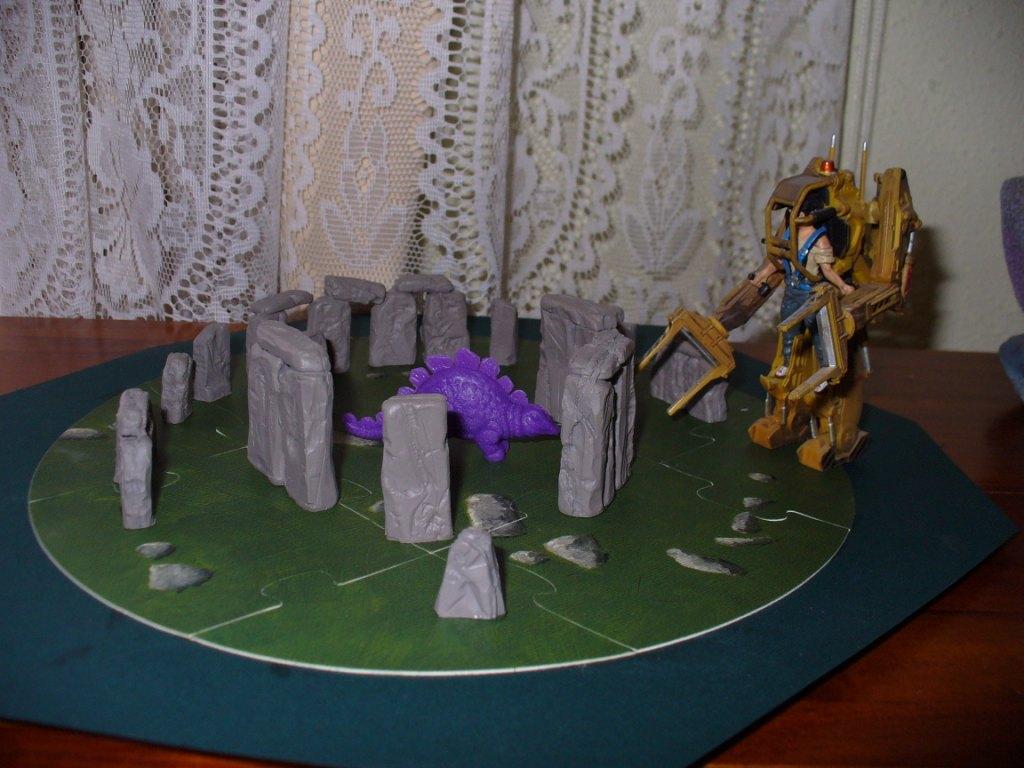 Ripley takes care of a stegoaurus at Stonehenge