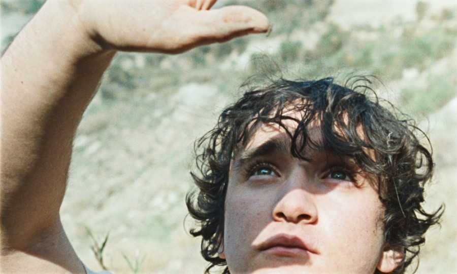 happy-as-lazzaro-2018-004-adriano-tardiolo-hand-to-sun.jpg