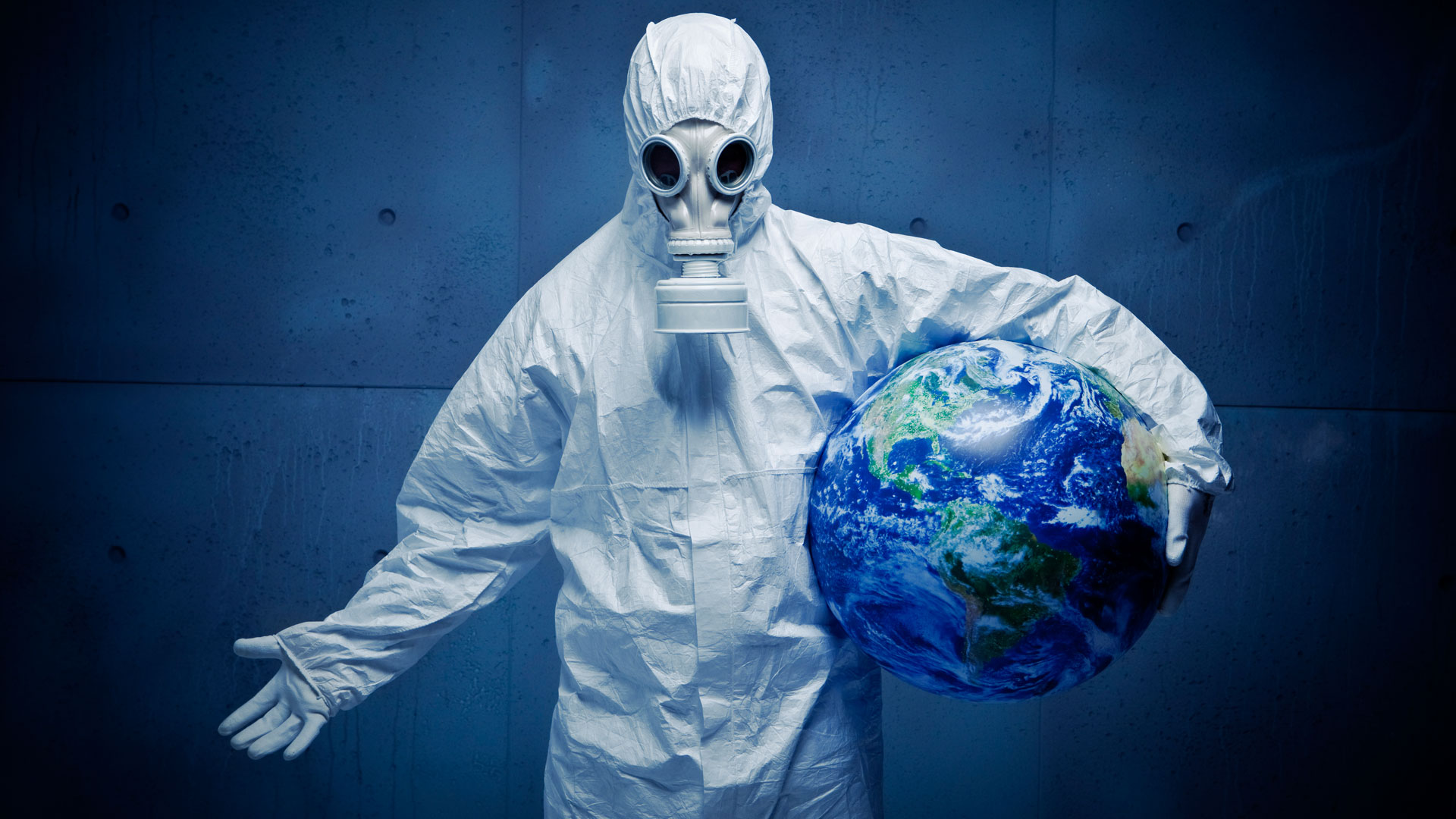 2020People_A_man_in_a_white_protective_suit_saves_the_planet_from_coronavirus_covid-19_142395_