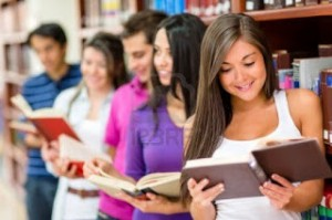 14317820-group-of-young-people-reading-books-at-the-library