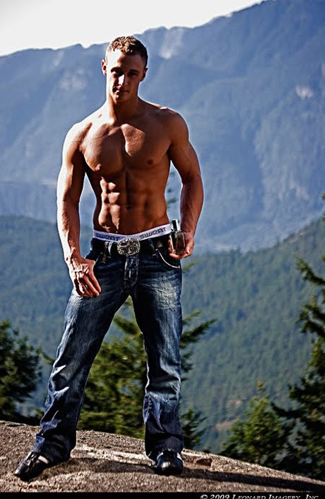 a man hunk in sweatundergear jeans on the moutain2