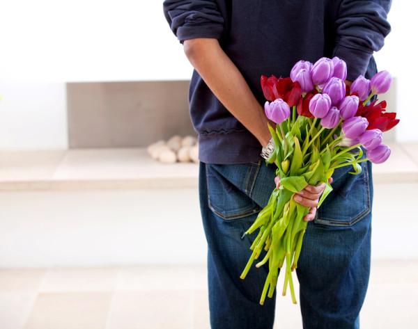 Man-brings-flowers