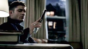 dean putting down gun