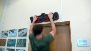 Макском висит на фигнере над дверью