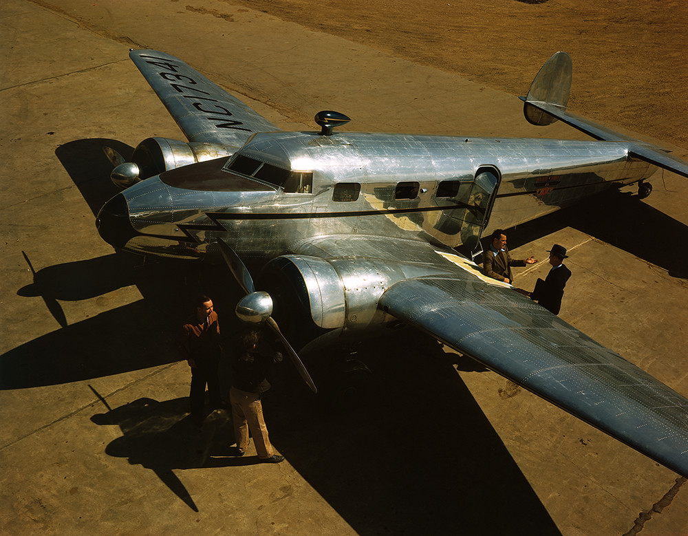 [Four Men with a Lockheed 12A Electra Junior]