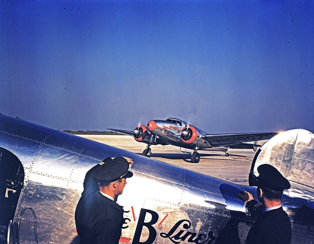 [Braniff Airline Pilots Watching a Lockheed 12A Electra Junior]