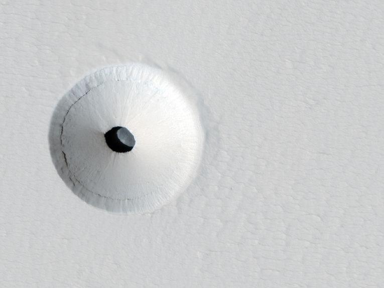 Пещеры и кратеры Марса.