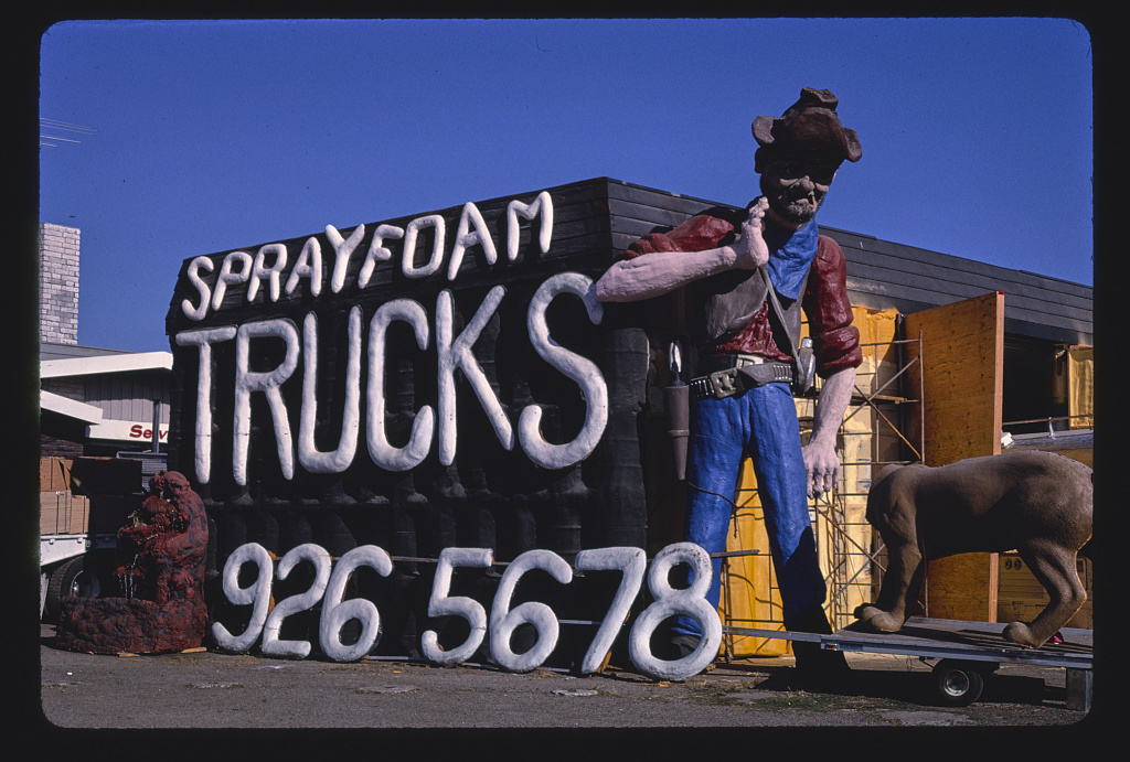Spray-foam-trucks-prospector-statue-and-sign-overall-view-Frontage-Road-I-5-1987.jpg