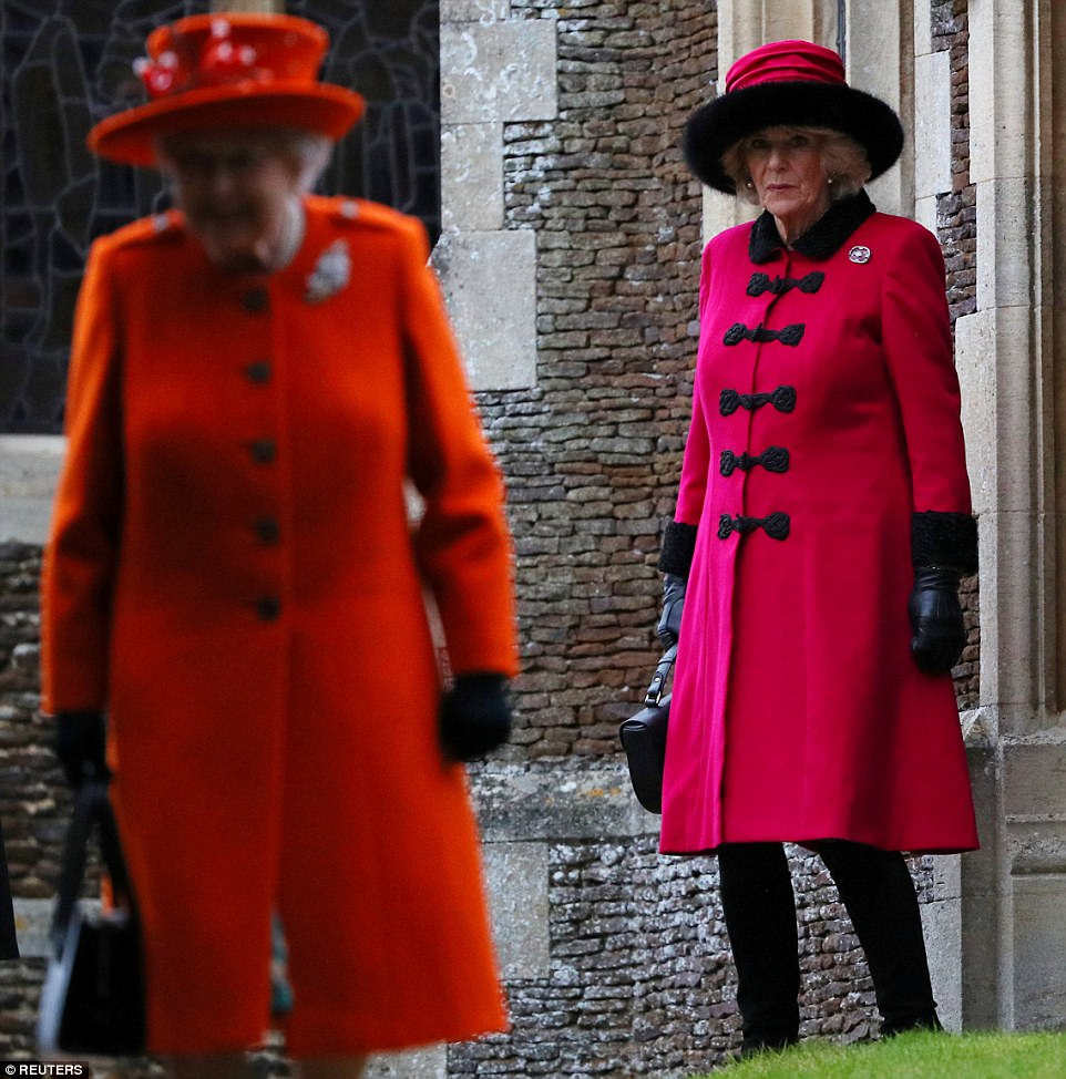 479159DD00000578-5211253-Meanwhile_Camilla_wore_a_bright_pink_jacket_and_a_matching_black-m-203_1514206993037.jpg