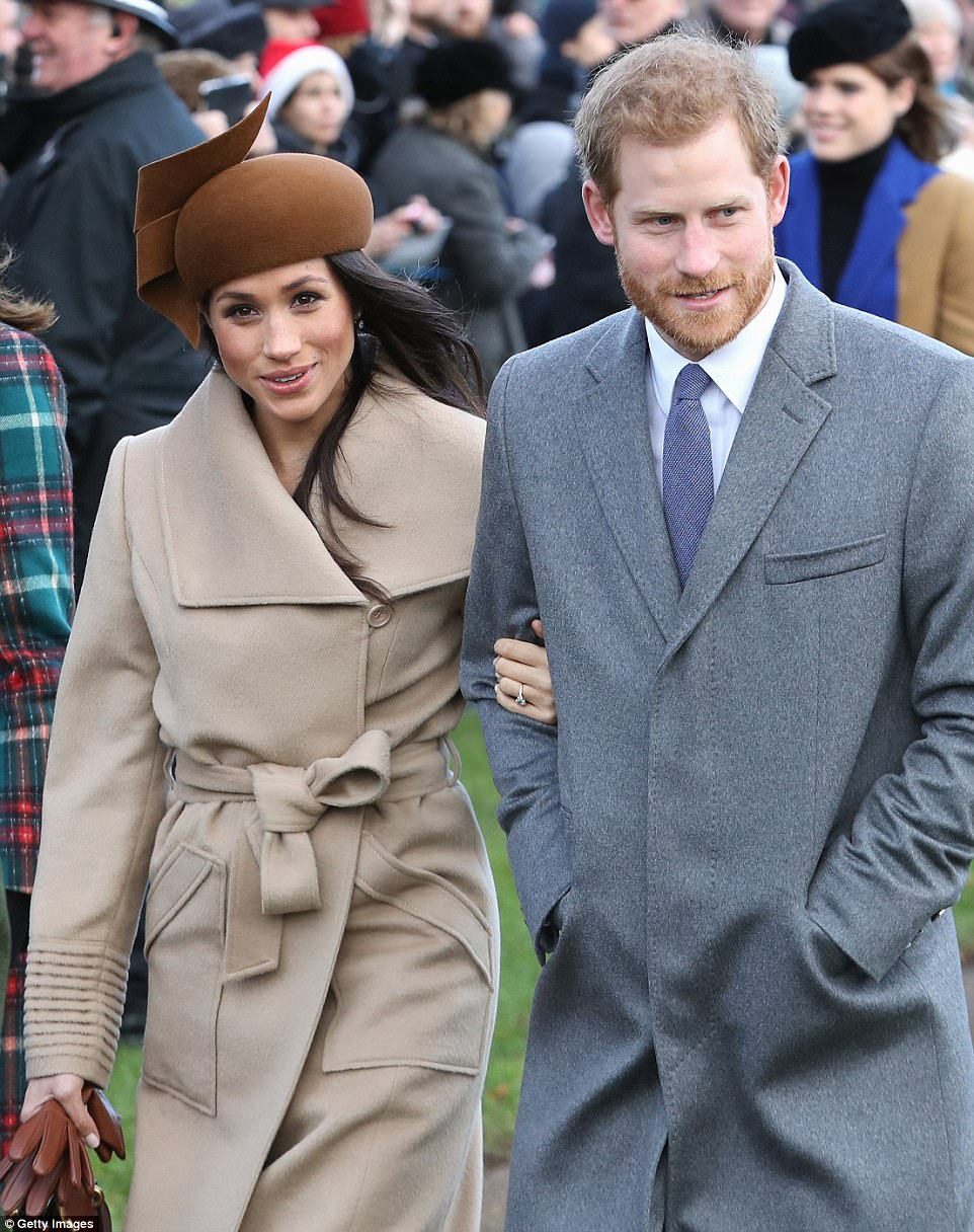 4791397C00000578-5211253-Meghan_seemed_at_ease_as_she_smiled_and_chatted_with_Prince_Harr-m-174_1514206145986.jpg