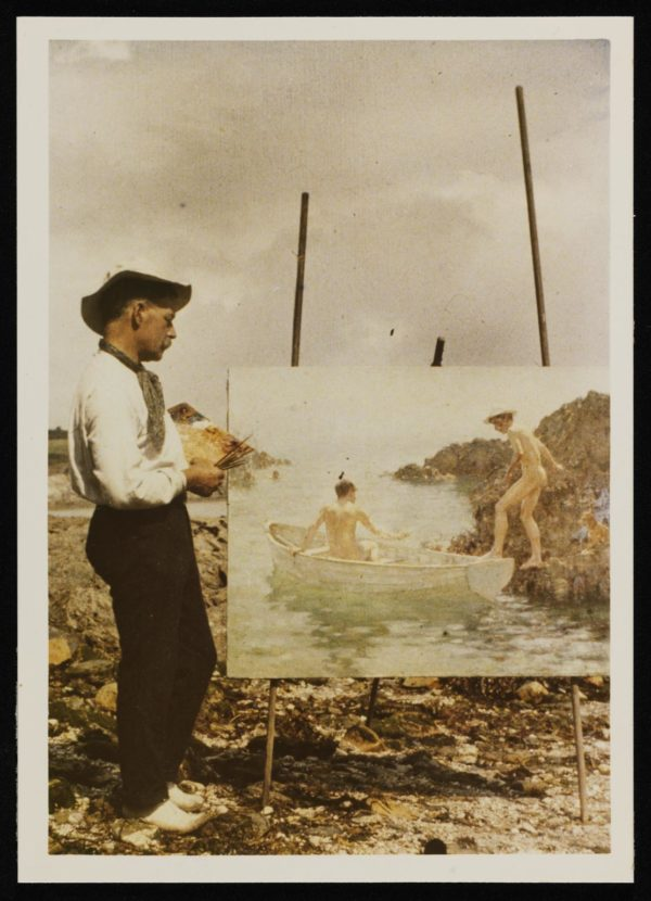 Colour glass transparency photograph of Henry Scott Tuke on the beach painting 'The Embarcation' (1914)   [c.1911-14] by Photographer Unknown