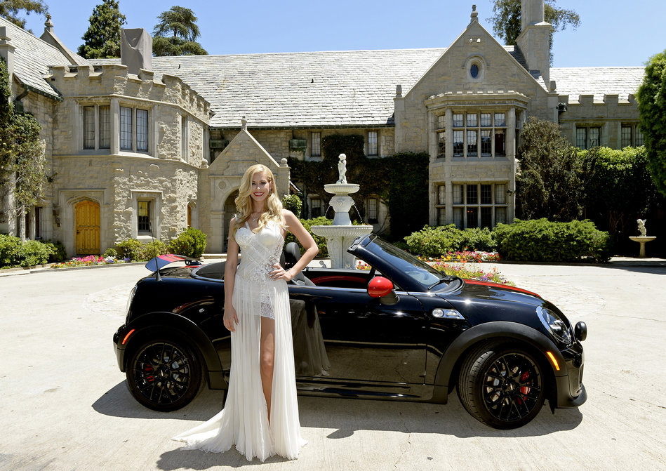 Summers, the 2014 Playboy Playmate of the Year, poses next to a Mini John Cooper Works Roadster at the Playboy Mansion in Los Angeles