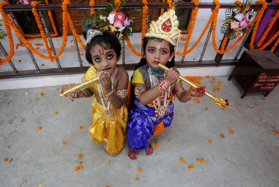 Children dressed up as Hindu Lord Krishna pose during Janmashtami festival celebrations in Agartala