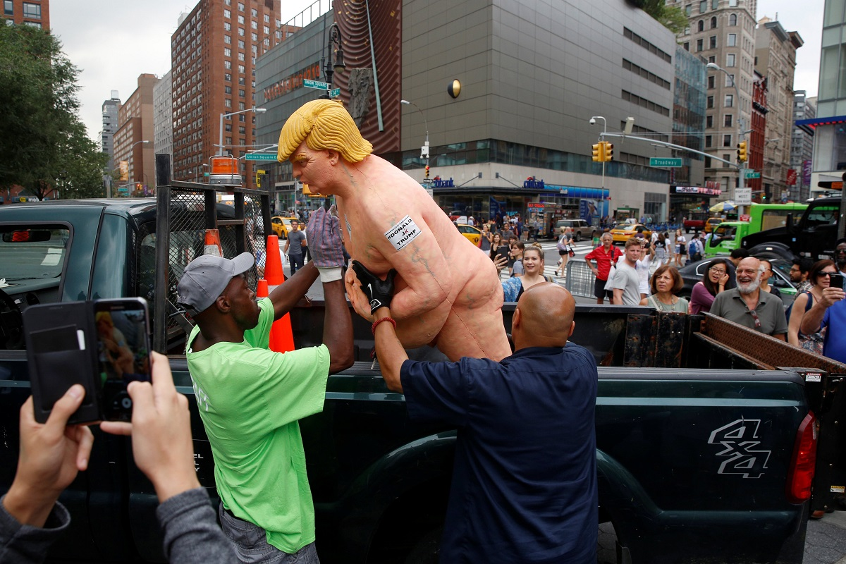 New York City Parks workers place a naked statue of U.S. Republican presidential nominee Donald Trump that was left in Union Square Park onto a truck in New York
