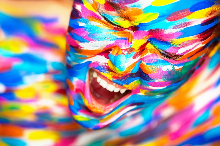 Portrait of the bright beautiful girl with art colorful make-up and body art