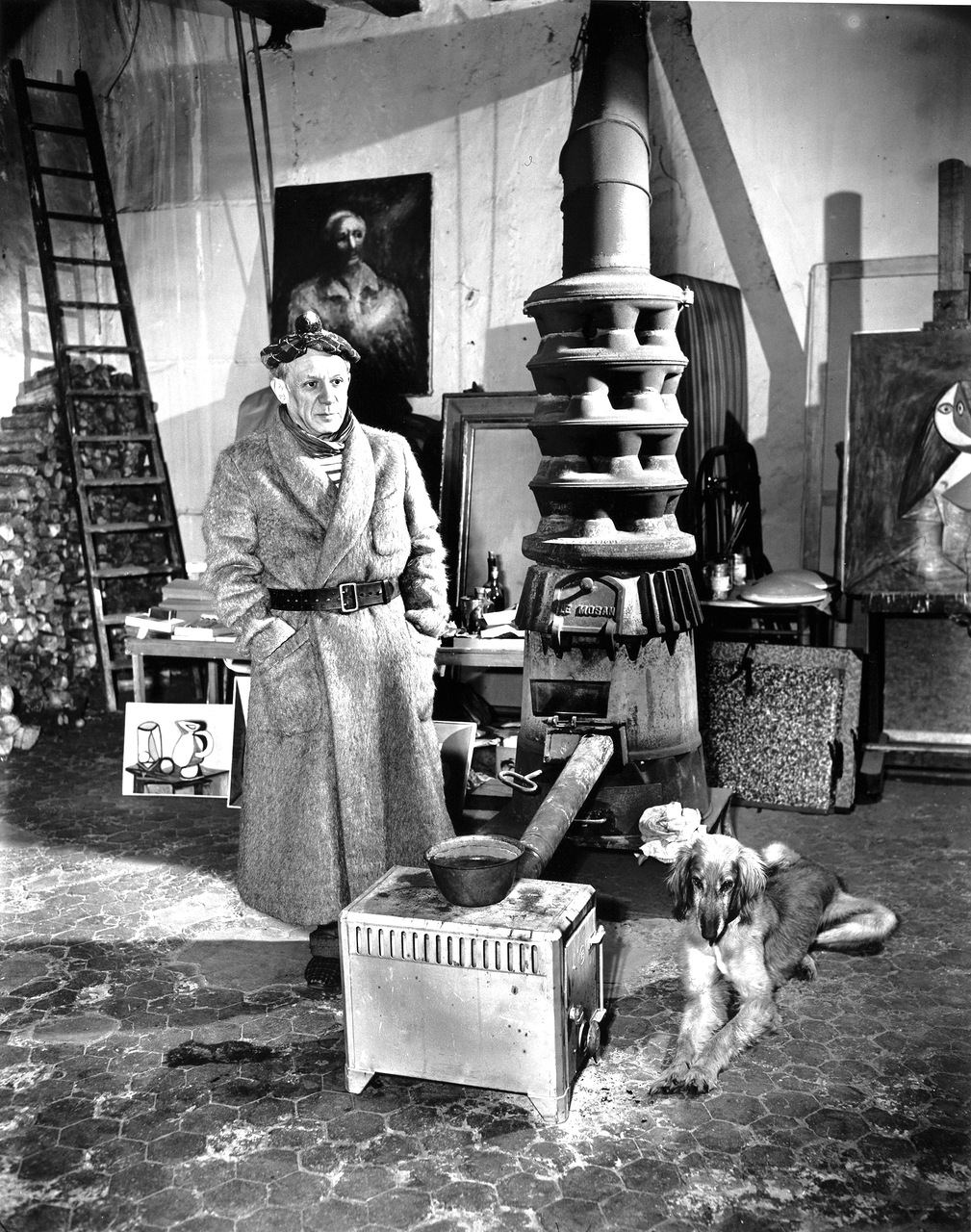 Picasso In Paris Studio, 1944.      Wood stove and Afghan hound.