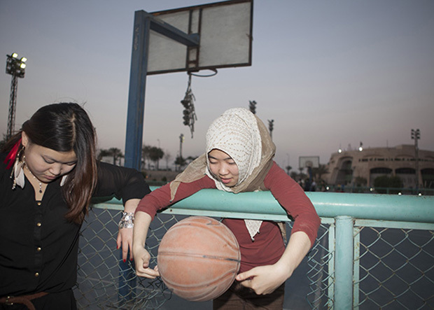 Egypt / Cairo / 9.3.2013 / Fatma, 22, Muslim (Huizu) from Henan talks with her friend (Hanzu, non Muslim) in a basketball court after they played, in a sport center nearby the airport in Cairo. © Giulia Marchi