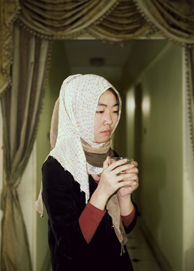 Egypt / Cairo / 8.3.2013. Ding Lan is pensive while she has a tea in her friends' house in Abbasseya, suburban quarter of Cairo. © Giulia Marchi