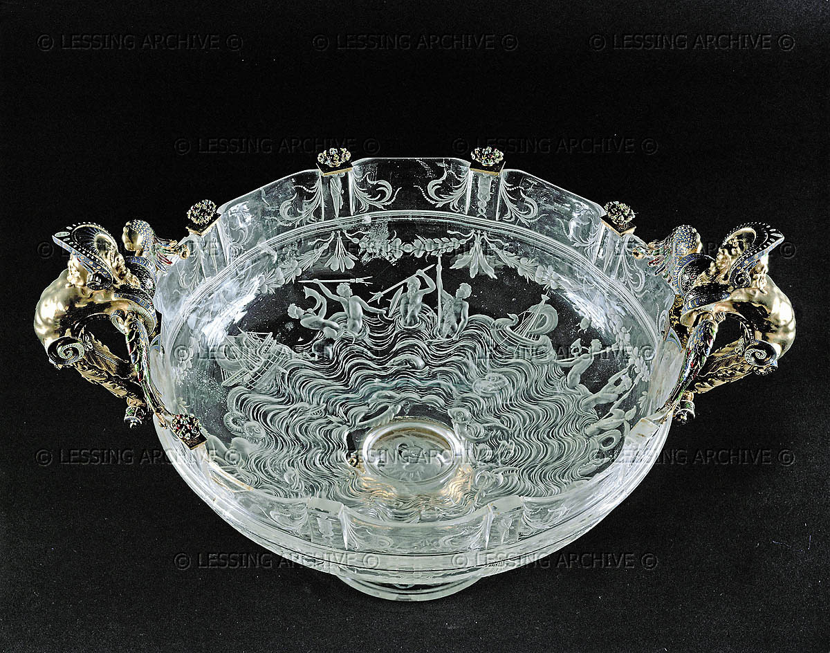 Rock-crystal cup with gilded manikin handles and tiny baskets of fruit around rim (mid 16th). Cup from Milan, gold ornaments from Florence. 19 x 25 cm