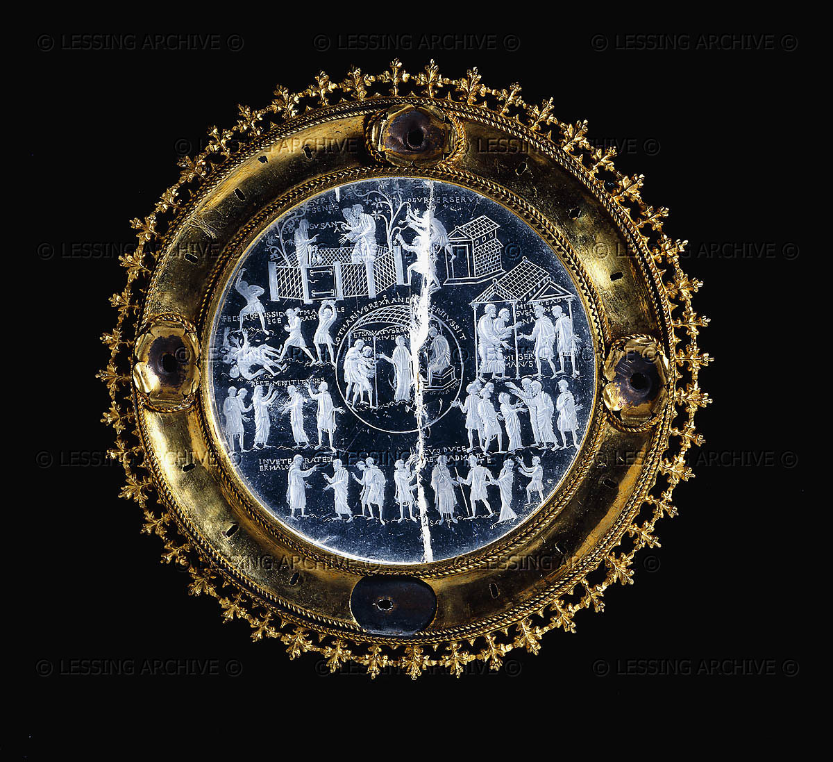 0310000246 The Lothar, or Susanna Crystal, c855-c869. The rock crystal is engraved with scenes of the story of Susanna as recorded in the Apocrypha. Each scene is accompanied by an inscription drawn from the Vulgate. In the first four scenes Susanna is