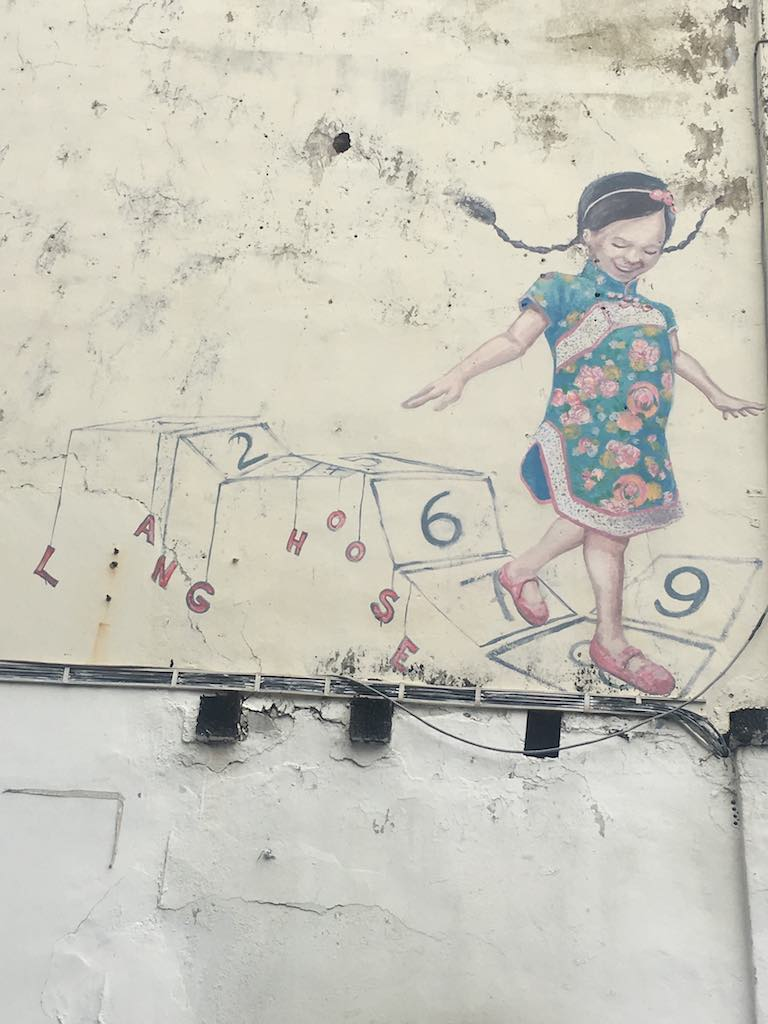Little-girl-with-Cheongsam-walking-on-Numbers-mural-in-Georgetown.jpg