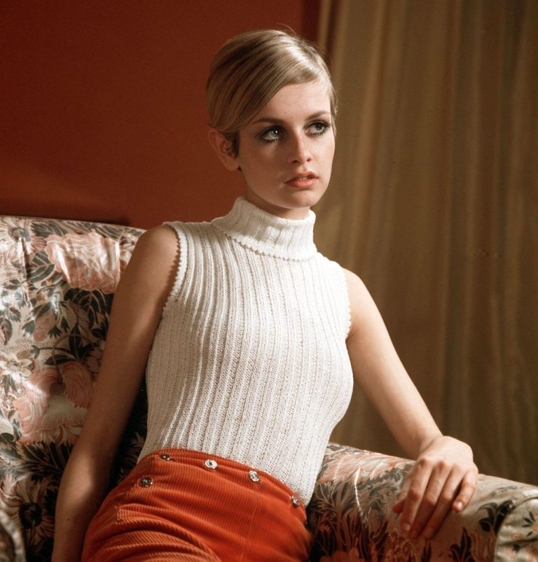 Twiggy-wearing-a-fashionable-white-jumper-whilst-sitting-on-a-sofa-1967-768x803.jpg