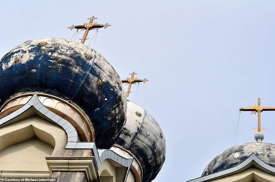 14777804-7140827-The_blue_and_gold_paint_on_the_church_s_domes_weathered_after_ye-a-78_1560522398016.jpg