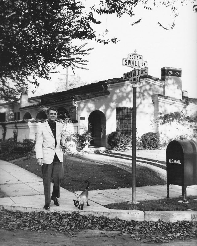 Cary Grant walking his Siamese cat in Beverly Hills, 1955. Photo by Sanford Roth.jpg