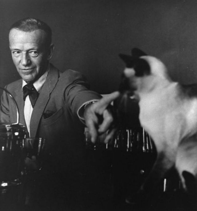 Fred Astaire pointing at his Siamese cat, 'Carlyle,' 1962. Photo by John Swope-LIFE.jpg