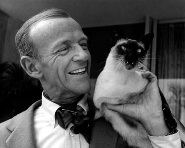 Fred Astaire with his Siamese cat, 'Carlyle,' on his shoulder, 1962. Photo by John Swope-LIFE.jpg