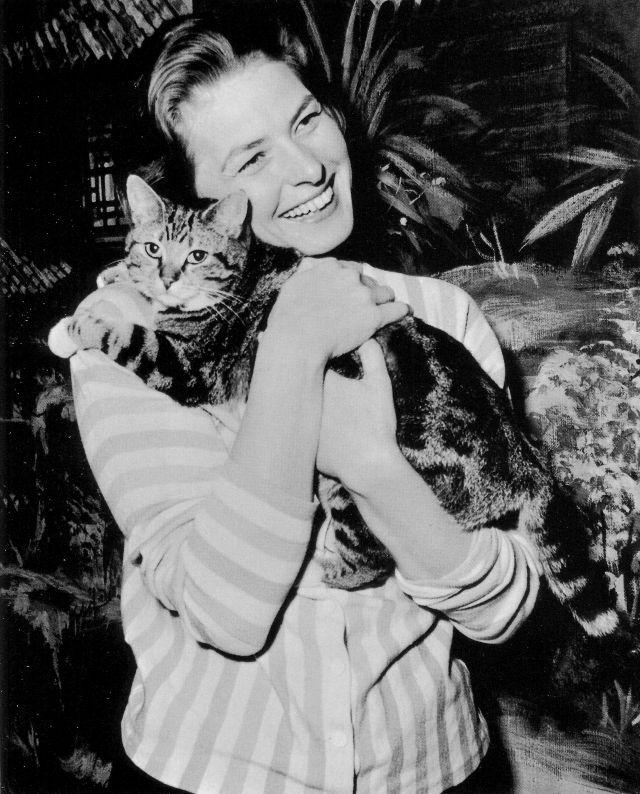 Ingrid Bergman hugging cat while on filming set at Elstree, England, 1958. Photo from Bettmann Archive.jpg