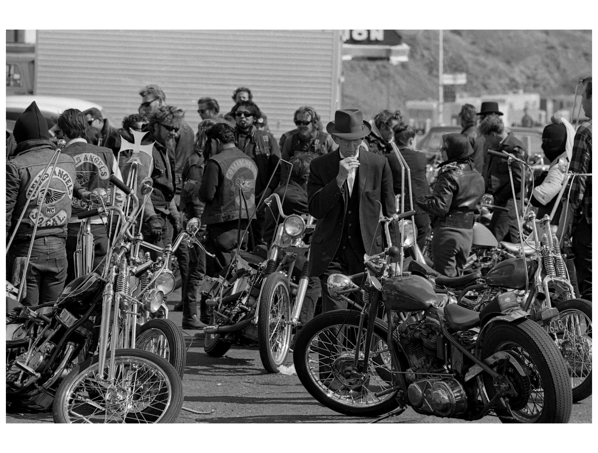 a-man-in-bakersfield-calif-casts-what-appears-to-be-an-appraising-eye-over-the-hells-angels-harley-davidsons-1965.jpg